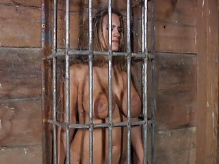 Irresistible woman in bondage screams while suffering through a punishment