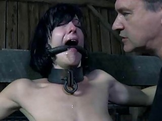 Good looking girl strapped and humiliated on bondage device BDSM