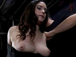 Young chick strapped to a bondage device by master BDSM