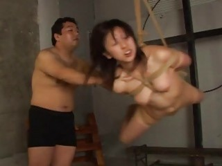 Mature Asian dude gets his slave to suck his cock