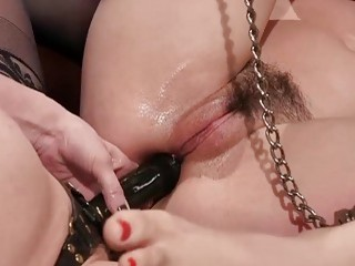 Submissive woman gets her pussy fingered by her sadistic mistress