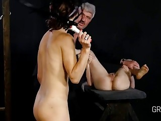 Brunette spreads her legs and gets flogged on the pussy