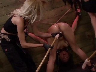 Her pussy and her anus get fingered by two dommes