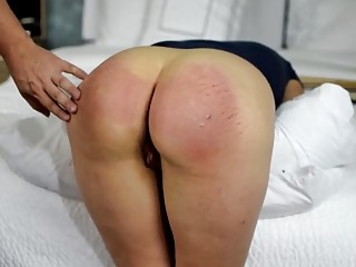 Babe gets spanked on her big fat butt with belt