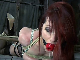 Charming redhead loves being in bondage while wearing black stockings