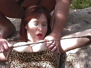 Slave master whips busty bound bitch outdoors BDSM fetish porn
