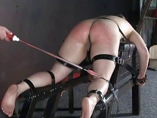 Bound MILF slave's ass is severely punished with electric wand