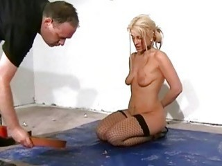 Blonde slave is degraded and humiliated in bizarre BDSM session