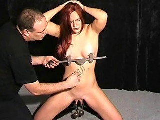 Extreme pussy torture and nipple clamps of debutant in BDSM