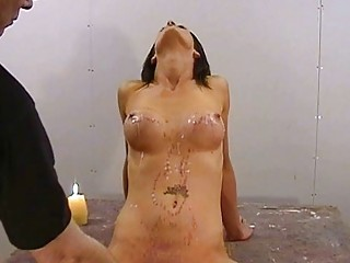 Submissive brunette enjoys her BDSM hot waxing and hard spanking