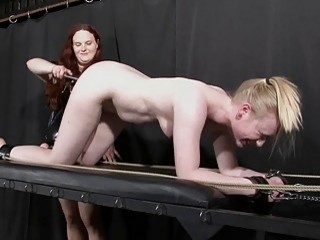 Blonde slave gets punished with hot wax by chubby dominatrix
