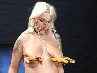Busty blonde slave girl's big natural boobs are totally dominated