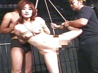 Sexy submissive Asian babe smiles as she gets tightly roped
