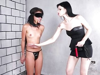 Debaucherous young short-haired girl slapped by her hot lesbian mistress