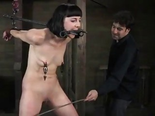 BDSM slut Coral Aorta gets restrained and molested by master