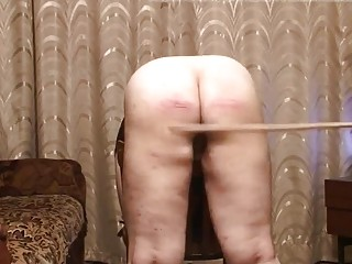 Slave gets caned on her ass until she bleeds hard