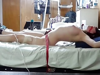 Babe is tied up to the bed and she struggles