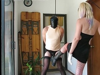 Blonde mistress kicks her submissive slave in the balls hard