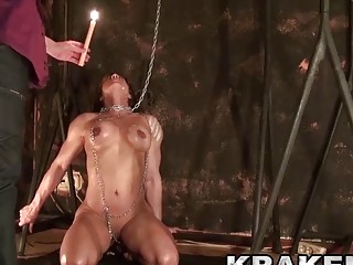 Cutie gets her neck chained and tits teased with wax