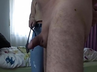 Teasing this guy's cute little cock with a big whip