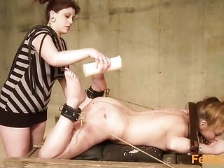Cute girl is tied up and forced to eat pussy