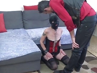 Girl in latex mask on her knees getting dominated gently