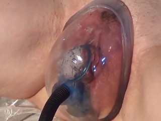 Inflating a hairy pussy and torturing it with a pump