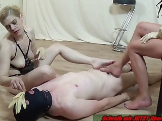 Pale dude gets his tiny cock stepped on by domme