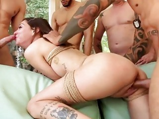 Girl with cute small titties dominated by four big dudes