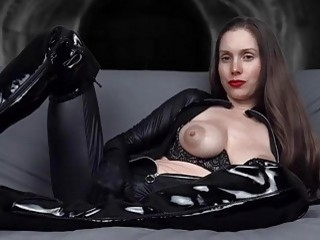 Assertive dominatrix shows off her big titties and her heels