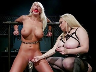 She ties this lesbian up and tortures her little pussy