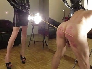 Dude bends over and gets spanked hard by his mistress