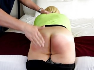 Big booty girl bends over and takes a harsh spanking