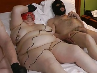 Mature woman shows off her titties and dude's cock tortured