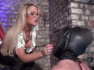 Dude in leather suit worships feet and gets slapped hard