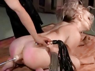 Blonde girl destroyed by a fuck machine in dungeon BDSM