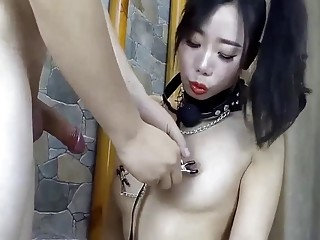Asian sex slave enjoys BDSM anal while wearing a ballgag