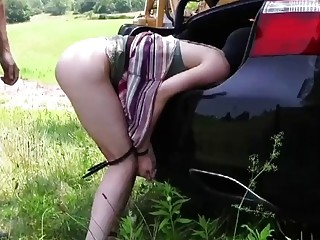 Maledom bondage session outside with a submissive petite brunette girl