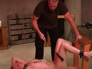 Naked slave girl enjoys BDSM and bondage with her master
