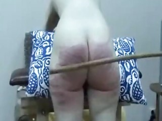 Submissive naked amateur obeys BDSM and extreme spanking her ass