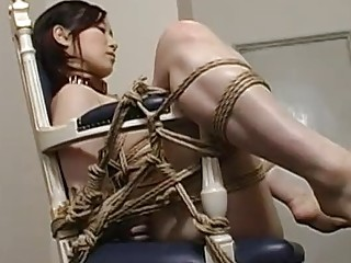 Horny Asian loves BDSM and having someone touching her pussy