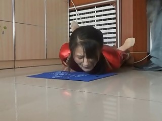 Sluty Asian girl enjoys BDSM and whipping on a floor