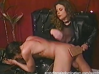Mature mistress enjoys BDSM spanking and femdom with her slave