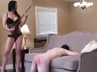 Babe in lingerie gives a spanking punishment to her slave