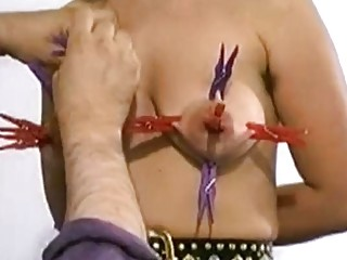 Amateur slave is pain as her master toys her tits