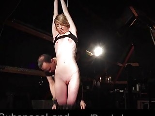 Slim naked girl enjoys BDSM and bondage with her master